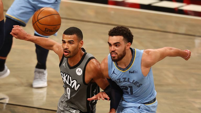 Timothe Luwawu-Cabarrot #9 of the Brooklyn Nets and Tyus Jones #21 of the Memphis Grizzlies pursue the loose ball at Barclays Center on December 28, 2020 in New York City.