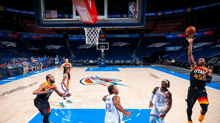 Donovan Mitchell #45 of the Utah Jazz puts the Utah Jazz ahead with 7 seconds left in the fourth quarter during the game against the Oklahoma City Thunder on December 28, 2020 at Chesapeake Energy Arena in Oklahoma City, Oklahoma.