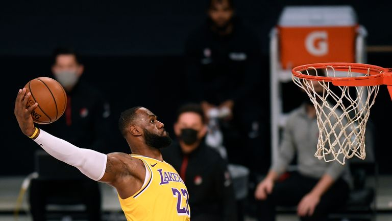 LeBron James #23 of the Los Angeles Lakers dunks during the first half against the Portland Trail Blazers at Staples Center on December 28, 2020 in Los Angeles, California.