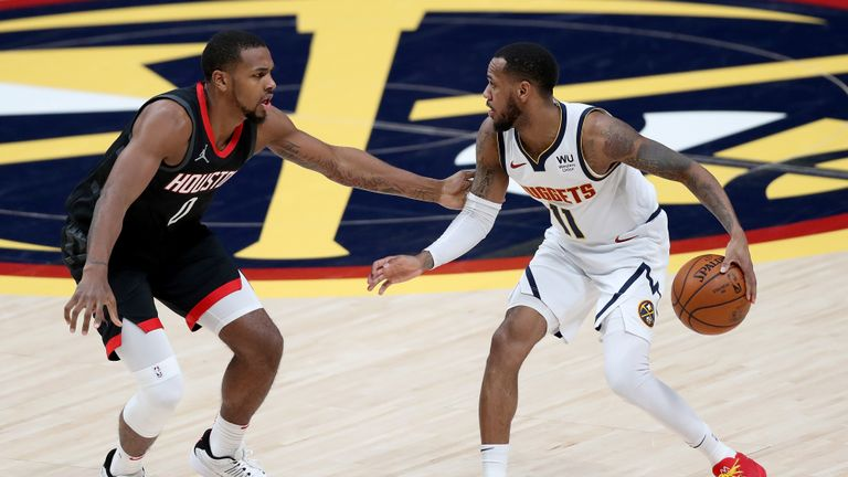 Monte Morris #11 of the Denver Nuggets drives against Sterling Brown #0 the Houston Rockets in the second quarter at Ball Arena on December 28, 2020 in Denver, Colorado.