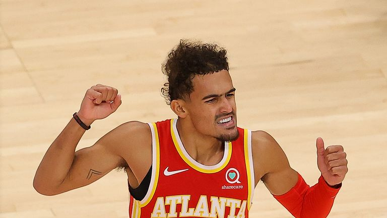 Trae Young #11 of the Atlanta Hawks reacts during the first half against the Detroit Pistons at State Farm Arena on December 28, 2020 in Atlanta, Georgia.