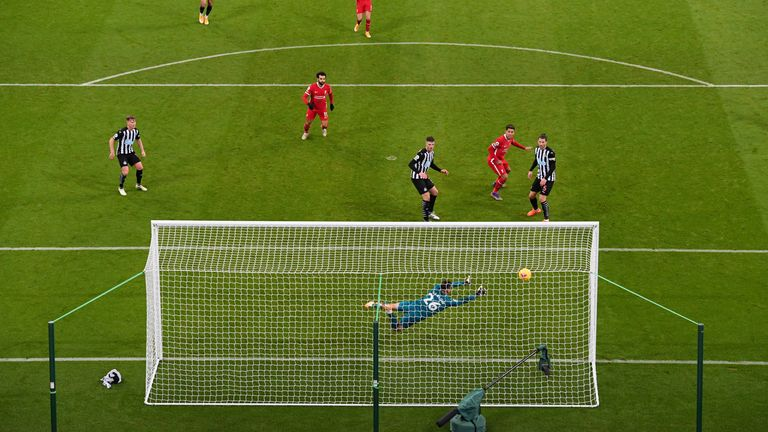 Karl Darlow gets across to keep out Roberto Firmino's goalbound header