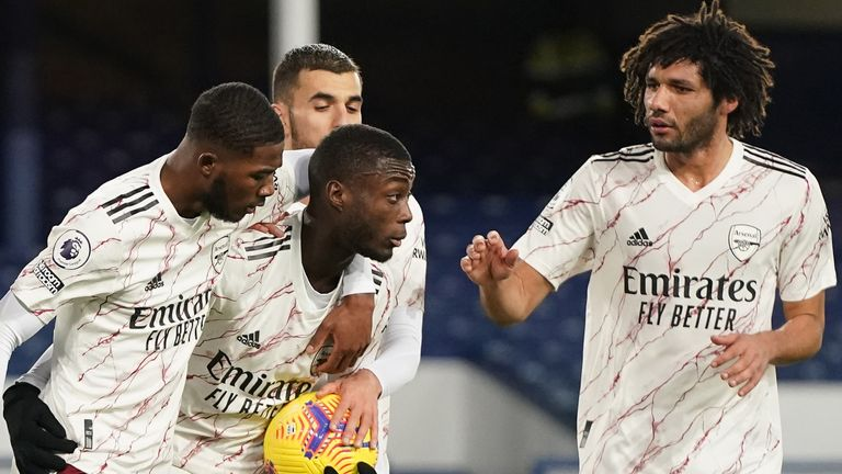 Nicolas Pepe of Arsenal celebrates with teammates Ainsley Maitland-Niles, Mohamed Elneny and Dani Ceballos after scoring their team's first goal from the penalty spot during the Premier League match between Everton and Arsenal at Goodison Park