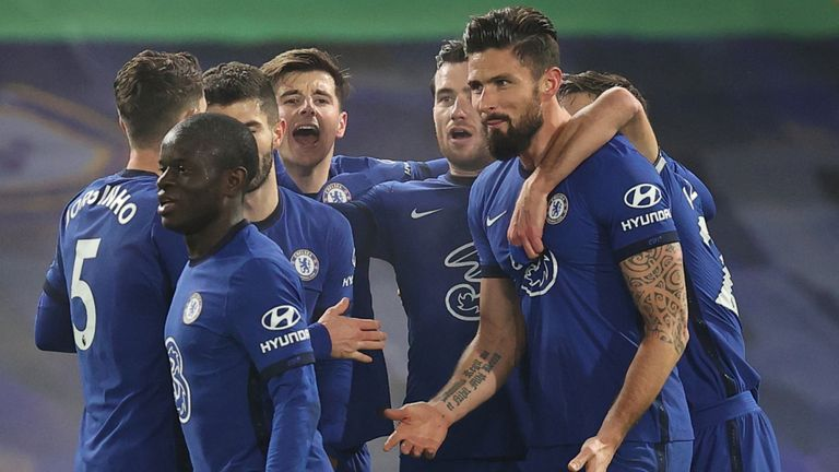 Chelsea players celebrate with Olivier Giroud after he opened the scoring against Aston Villa