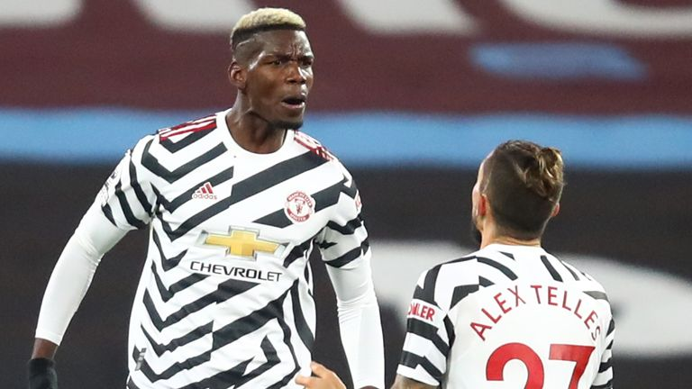 Paul Pogba celebrates with Alex Teles after leveling for Manchester United at West Ham