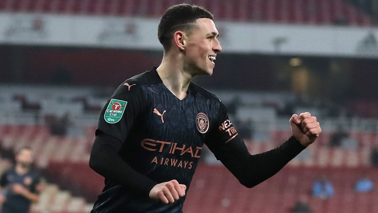 Phil Foden celebrates after putting Manchester City 3-1 up against Arsenal