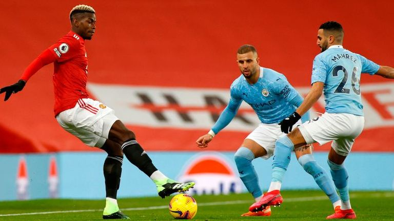 Paul Pogba tussles for the ball