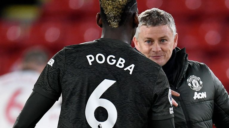 Paul Pogba with Manchester United manager Ole Gunnar Solskjaer