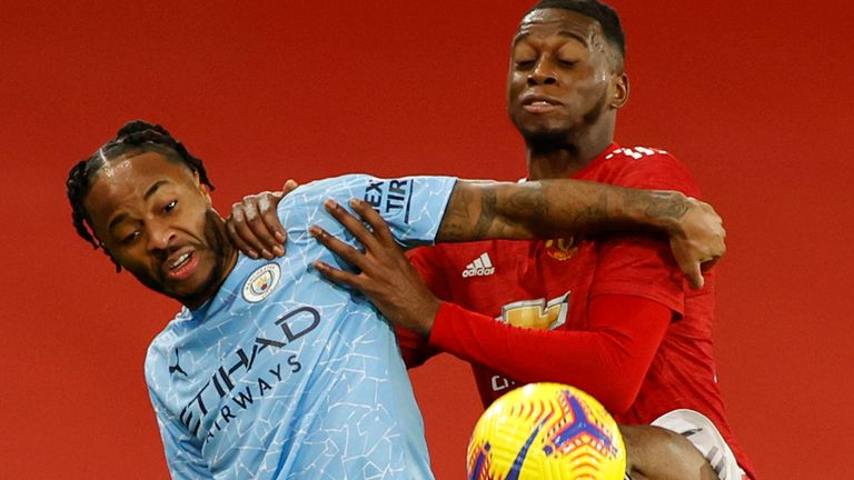 Raheem Sterling and Aaron Wan-Bissaka battle for the ball at Old Trafford