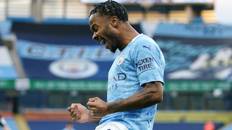 Raheem Sterling of Manchester City celebrates after scoring his team's first goal during the Premier League match between Manchester City and Fulham