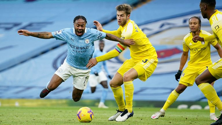 Raheem Sterling of Manchester City is fouled by Joachim Andersen of Fulham, leading to Manchester City being awarded a penalty