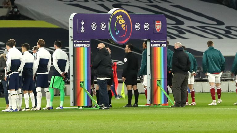LONDON, ENGLAND - DECEMBER 06: Both sets of players line up in front of the handshake board that is seen with Stonewall Rainbow Laces branding on, in support of their campaign prior to the Premier League match between Tottenham Hotspur and Arsenal at Tottenham Hotspur Stadium on December 06, 2020 in London, England.