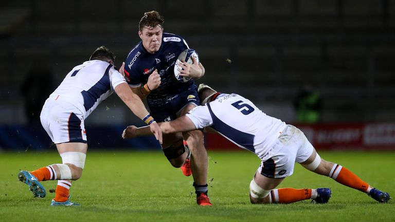 Sale's Cobus Wiese takes on the Edinburgh defence