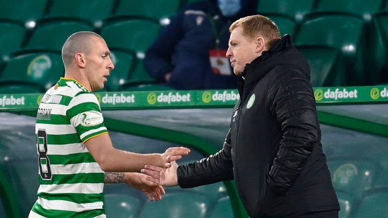 Celtic captain Scott Brown shakes hands with manager Neil Lennon