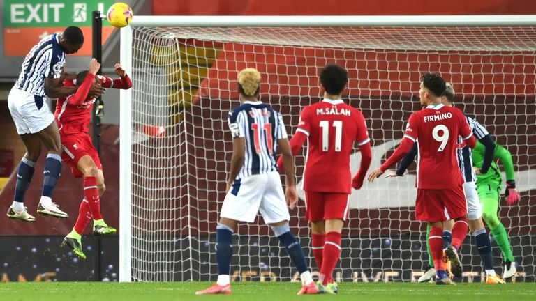 West Bromwich Albion's Nigerian defender Semi Ajayi scores their first goal during the English Premier League football match between Liverpool and West Bromwich Albion at Anfield