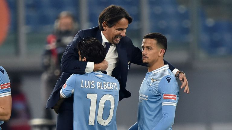 Simone Inzaghi celebrates with his players after Lazio's second goal