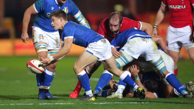 Stephen Varney gets the ball away for Italy