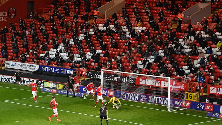 fans look on from their socially distanced position in the stands during the Sky Bet League One match between Charlton Athletic and Milton Keynes Dons