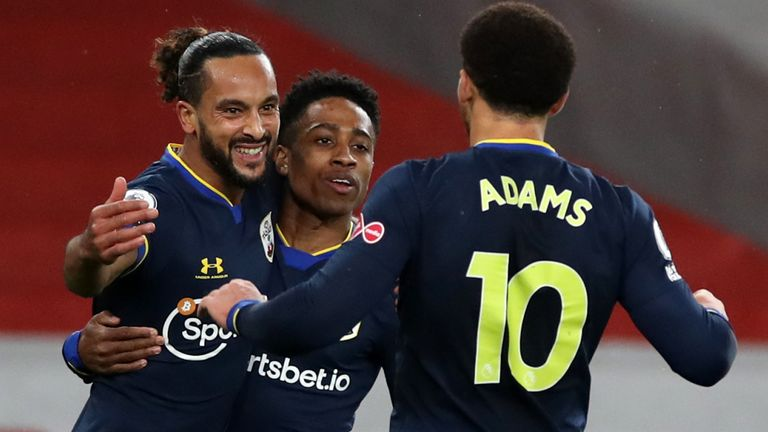 Theo Walcott celebrates his goal with team-mates