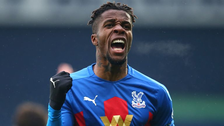 Wilfried Zaha celebrates after Darnell Furlong's own goal gives Crystal Palace the lead at West Brom