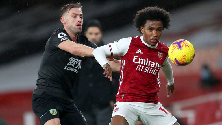 Arsenal's Willian (right) and Burnley's Charlie Taylor in Premier League action at the Emirates Stadium
