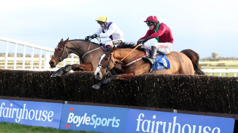 Agusta Gold ridden by jockey Danny Mullins (right) on their way to winning the John & Chich Fowler Memorial EBF Mares Chase race with Moyhenna ridden by jockey James Joseph Slevin in second at Fairyhouse Racecourse.
