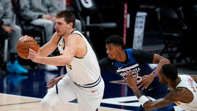 AP - Denver Nuggets center Nikola Jokic, left, heads down the court after intercepting a pass intended for Minnesota Timberwolves guard Jarrett Culver,