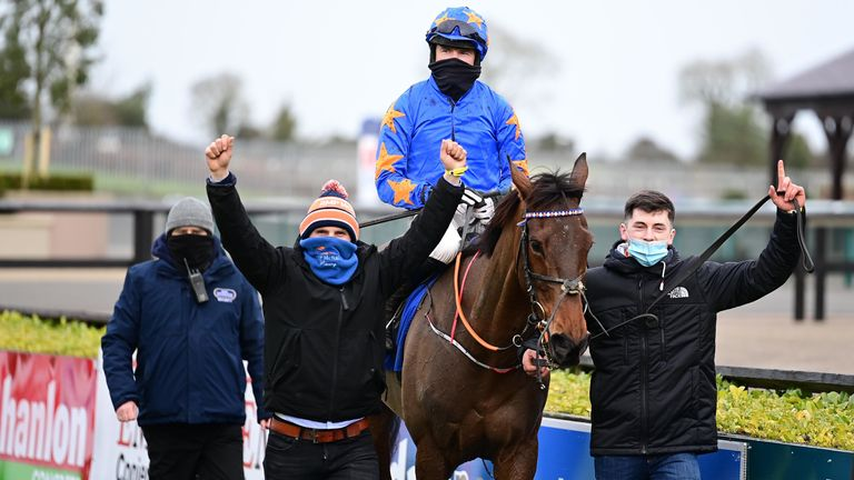 Dreal Deal ridden by jockey Denis O'Regan (centre) with owner & trainer Ronan McNally (left) and son Tiernan
