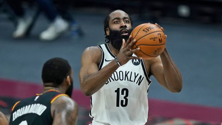 Brooklyn Nets' James Harden (13) shoots against the Cleveland Cavaliers during the second half of an NBA basketball game, Wednesday, Jan. 20, 2021, in Cleveland.