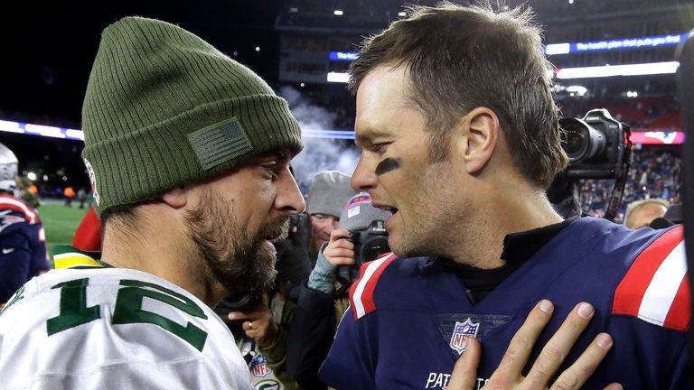 Green Bay Packers quarterback Aaron Rodgers and a then-New England Patriots Tom Brady speak at midfield after facing off in November 2018. (AP Photo/Steven Senne)