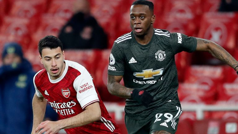 Aaron Wan-Bissaka and Gabriel Martinelli in Premier League action (AP)