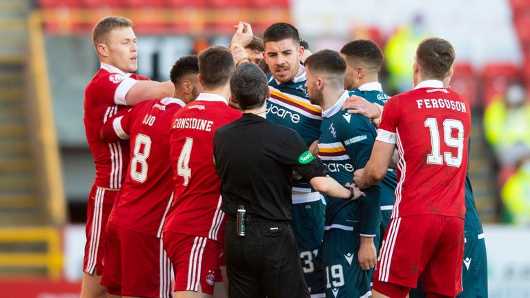 The two sets of players clash during the Scottish Premiership match