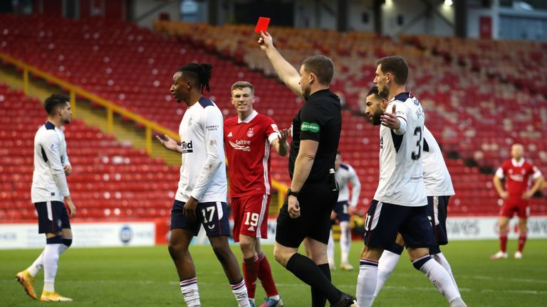 Aberdeen's Lewis Ferguson (centre) reacts to Aberdeen's Ryan Hedges (not pictured) being show a red.