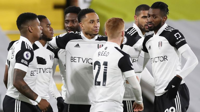 Ademola Lookman celebrates with team-mates after scoring for Fulham against Man Utd