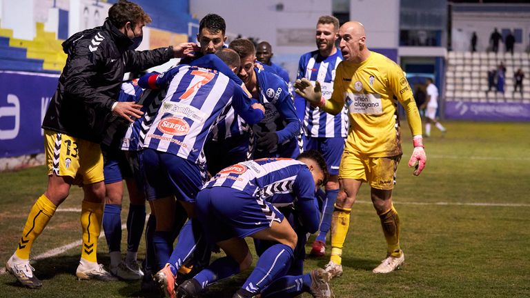The entire Alcoyano celebrate after taking the lead against Real Madrid deep into extra-time