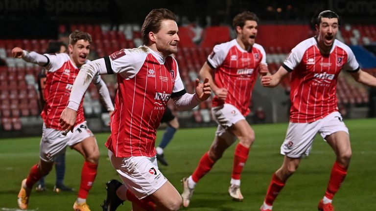 Cheltenham's Alfie May celebrates after giving his team the lead against Manchester City in the FA Cup
