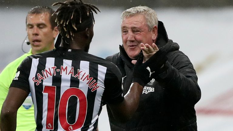 Newcastle's Allan Saint-Maximin, left, celebrates with Newcastle's head coach Steve Bruce after scoring his side's opening goal during the English Premier League soccer match between Newcastle United and Burnley at St. James' Park in Newcastle, England, Saturday, Oct. 3, 2020.