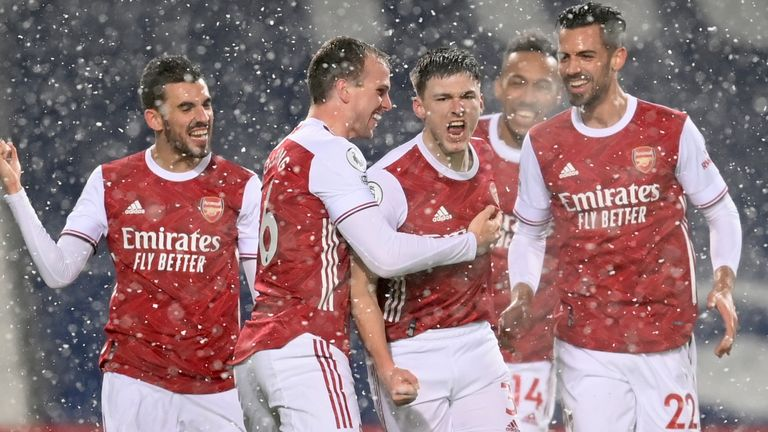 Arsenal celebrate a goal against West Brom