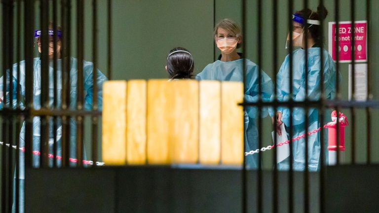 Quarantine staff wait for the arrival of tennis players ahead of the 2021 Australian Open tennis tournament