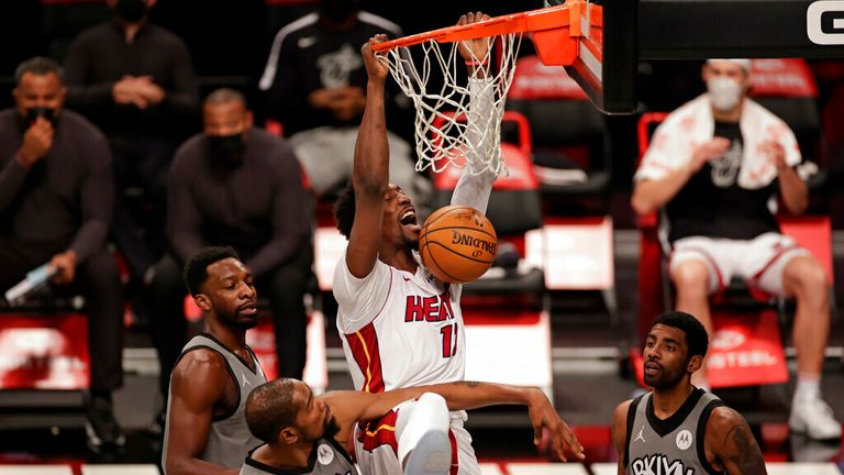 AP - Miami Heat center Bam Adebayo dunks over Brooklyn Nets forward Kevin Durant (7) and guard Kyrie Irving (11)