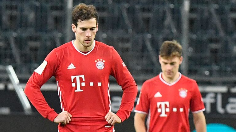 Bayern's Leon Goretzka (L) and Joshua Kimmich show their disappointment after a 3-2 defeat