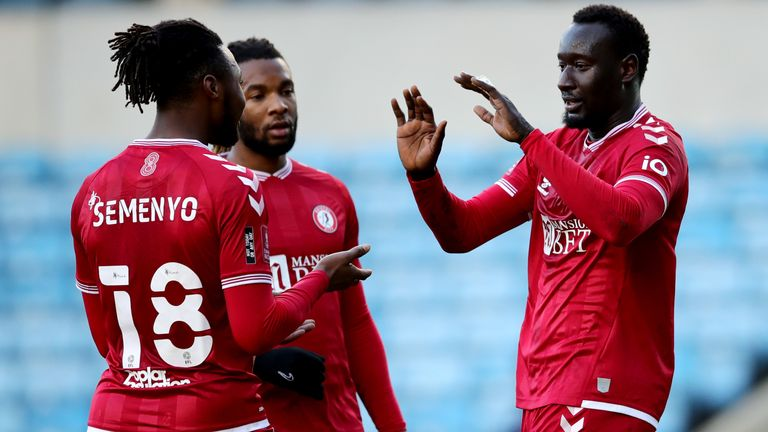 Bristol City's Famara Diedhiou (right) celebrates after scoring against Millwall