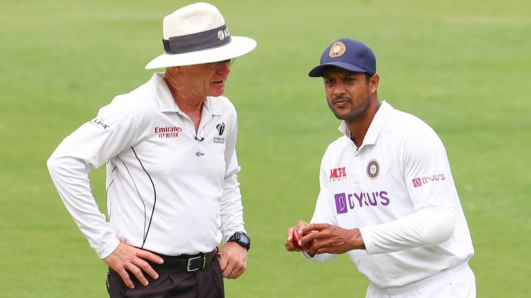 Oxenford talks to India's Mayank Agarwal during his final Test as an umpire in Brisbane in early January