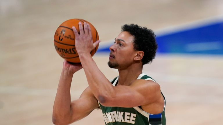 Milwaukee Bucks guard Bryn Forbes shoots during the first half of an NBA basketball game against the Detroit Pistons