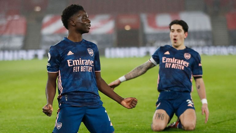Arsenal's Bukayo Saka celebrates after scoring his side's second goal (AP)