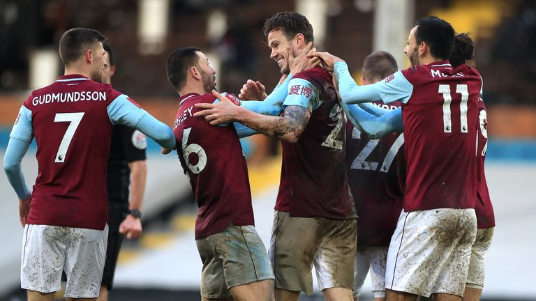 Burnley celebrate Kevin Long's goal to make it 3-0 at Craven Cottage