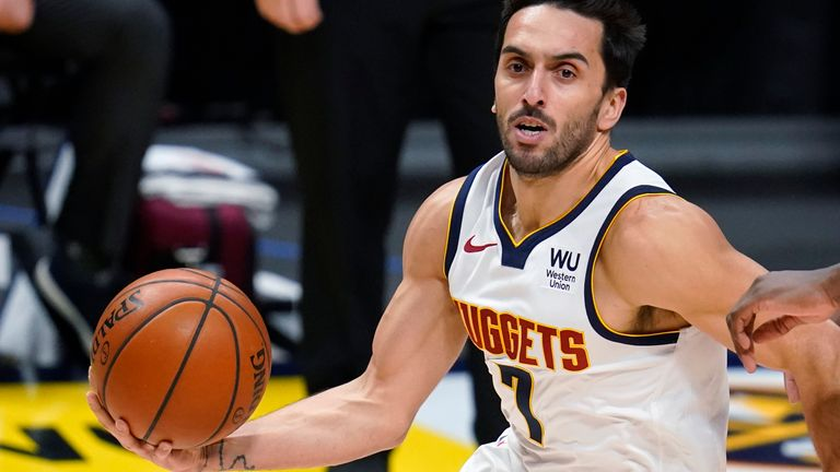 Denver Nuggets guard Facundo Campazzo, left, drives past Minnesota Timberwolves center Naz Reid during the first half of an NBA basketball game Tuesday, Jan. 5, 2021, in Denver.