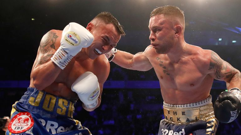 Frampton (right) and Josh Warrington in action in the World Featherweight Championship at Manchester Arena in December  2018