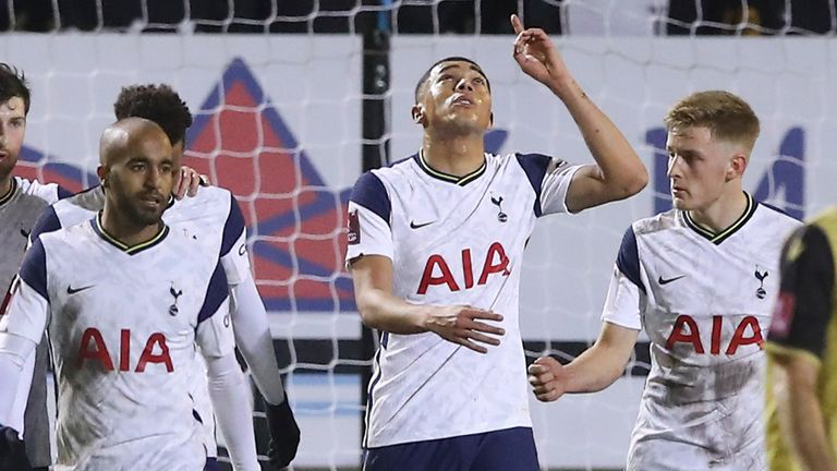 Carlos Vinicius points to the sky after completing a first-half hat-trick - Martin Rickett/Pool via AP