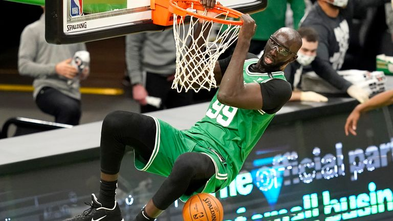 Boston Celtics center Tacko Fall (99) dunks during the fourth quarter of an NBA basketball game against the Orlando Magic